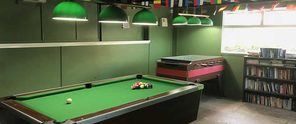 There is a games room with pool table, table football, table tennis and darts